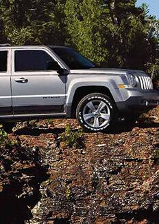 2015 Jeep Patriot side view on rocks