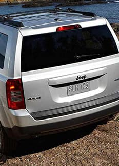 2015 Jeep Patriot rear view on rock