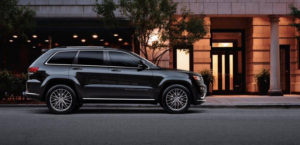 Black 2018 Jeep Grand Cherokee city building