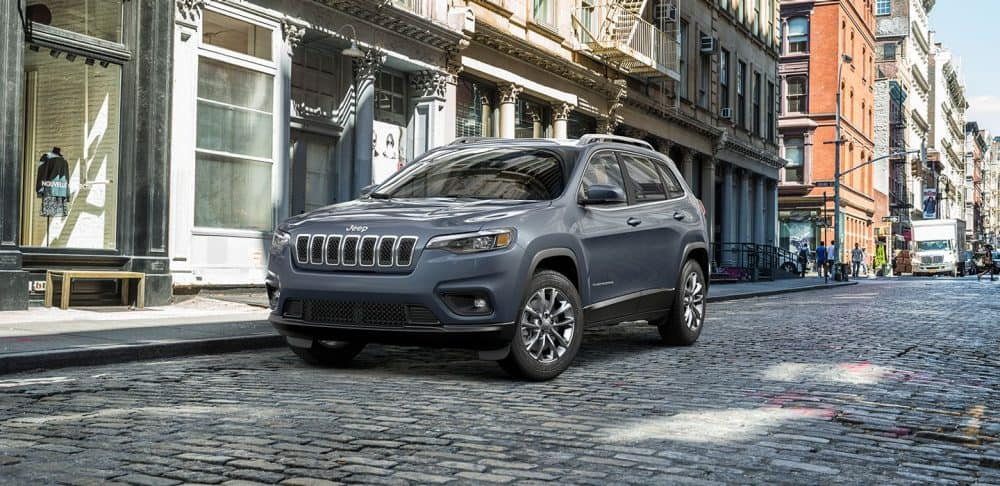 Blue gray 2019 Jeep Cherokee on brick road
