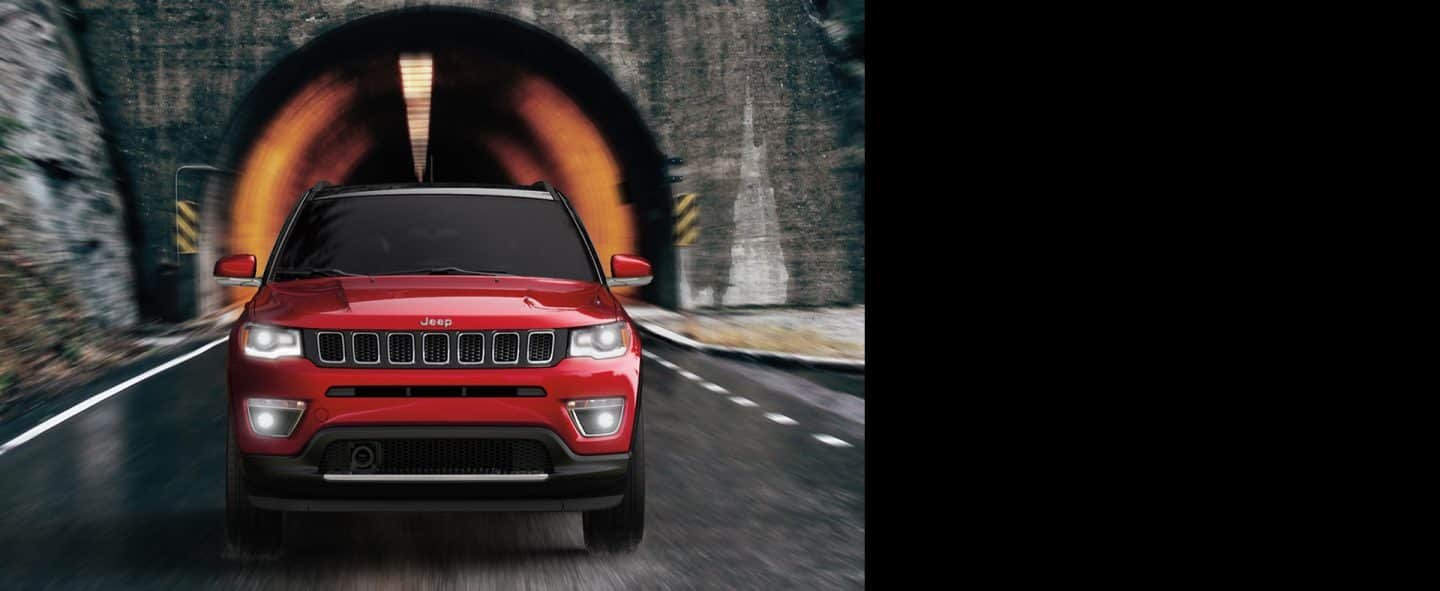 2019 Jeep Compass emerging from a tunnel.