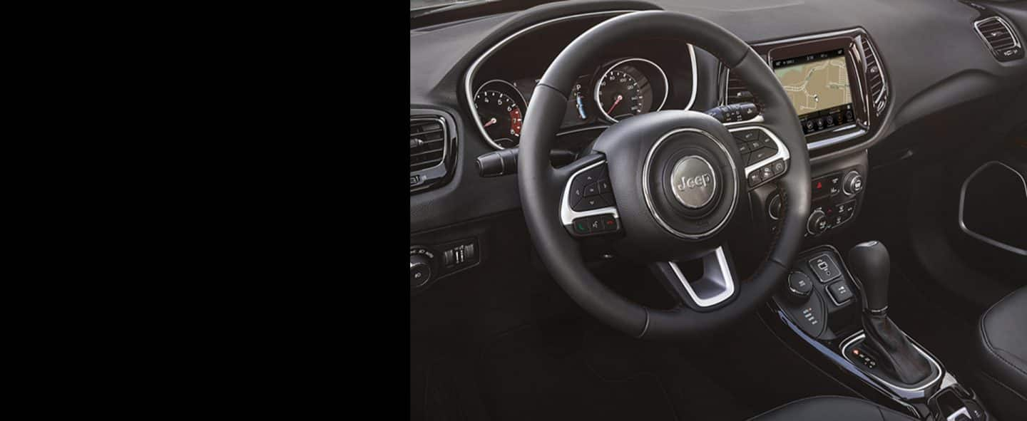 A closeup of the steering wheel in 2019 Jeep Compass