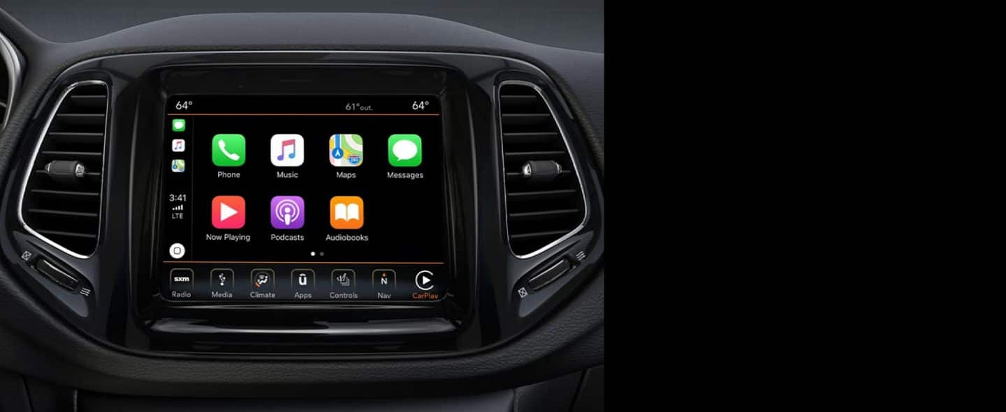 A closeup of the touchscreen in 2019 Jeep Compass with Apple CarPlay icons on-screen