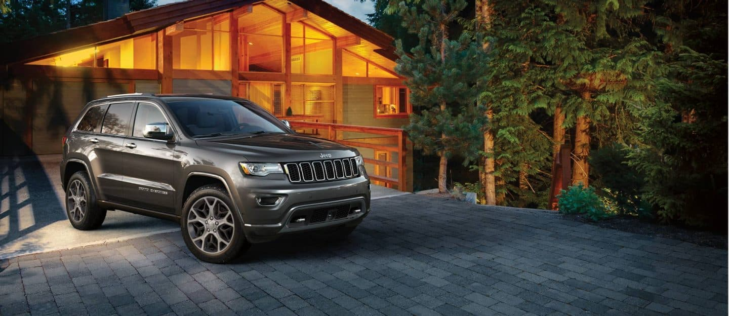 Jeep Grand Cherokee parked in a driveway.