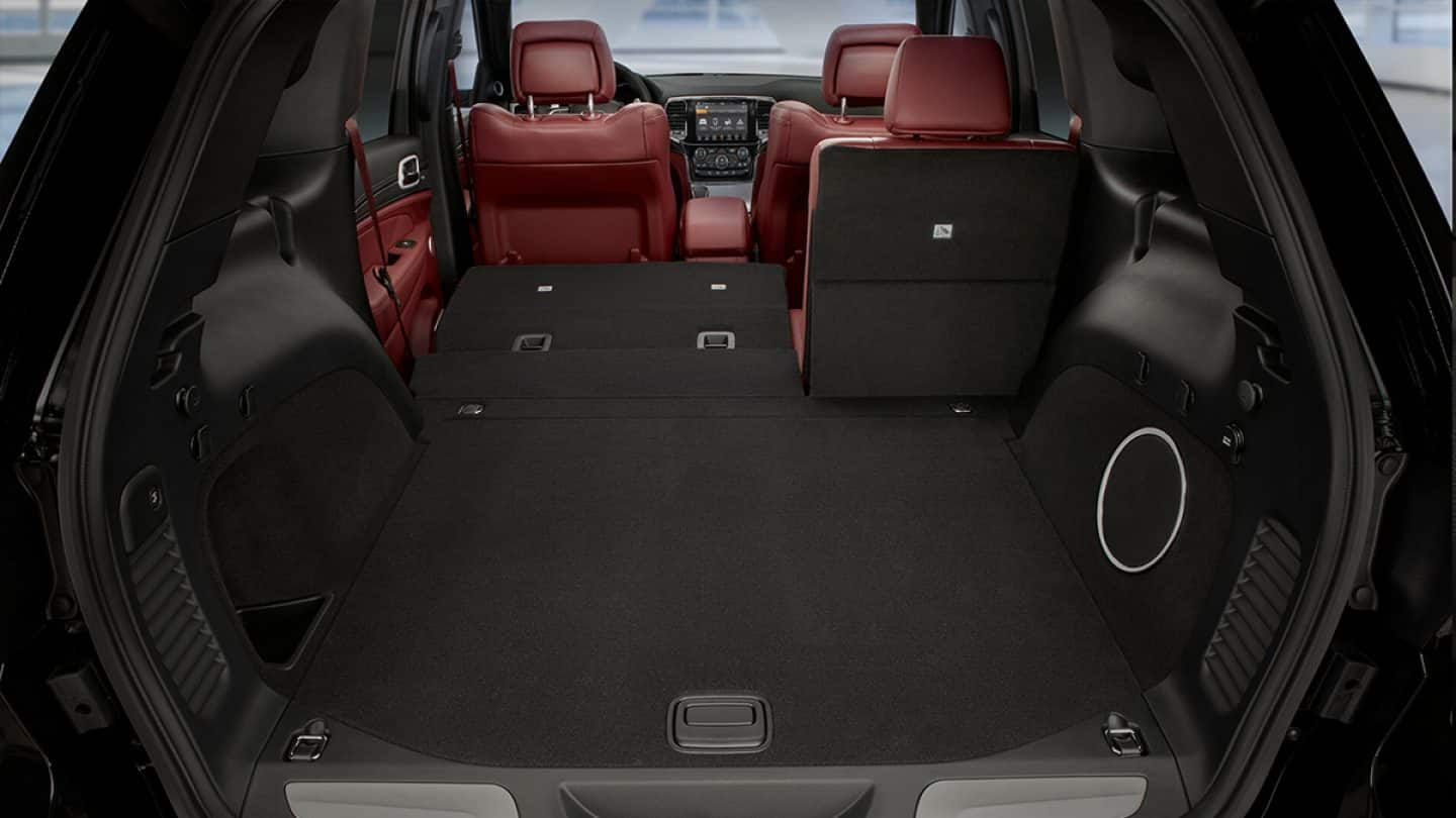 Rear compartment of Grand Cherokee with the 60 portion split rear seat folded down and 40 portion split seat upright.