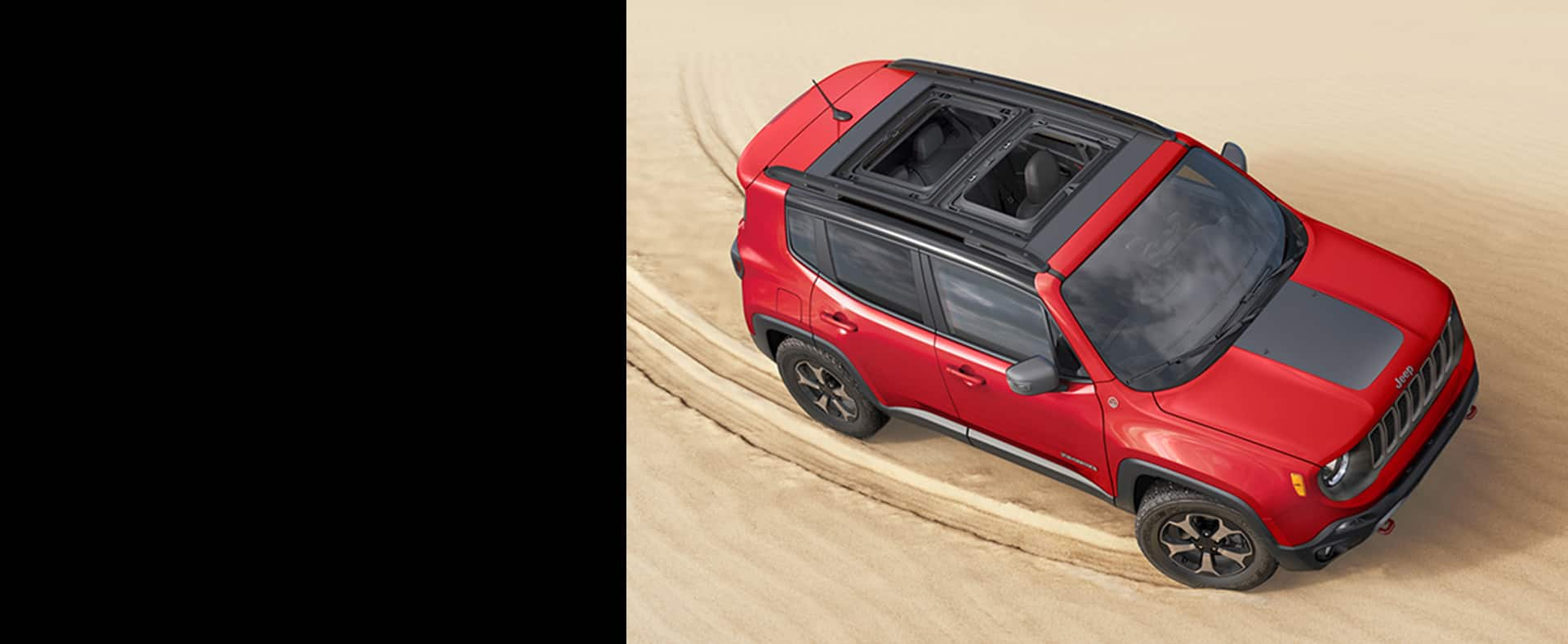 2020 Jeep Renegade leaves tracks in the sand behind it as it makes a sharp turn.