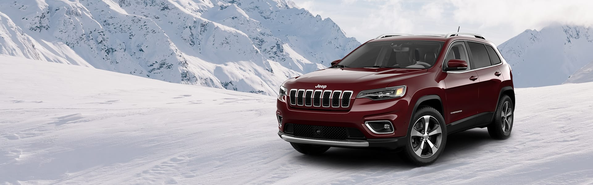 A 2021 Cherokee Limited 4x4 on a snow-covered trail in the mountains.