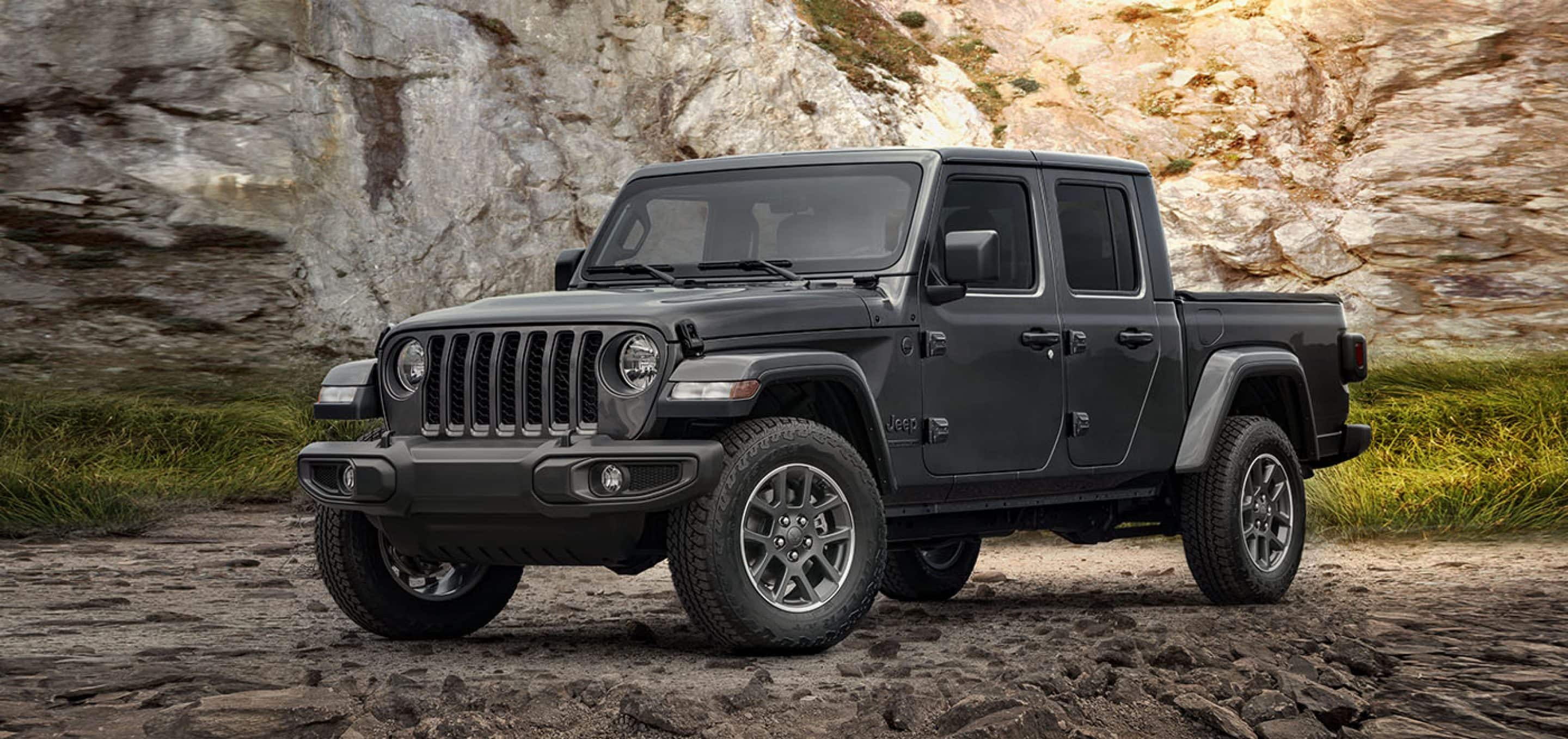 A gray 2021 Jeep Gladiator parked on rocky terrain