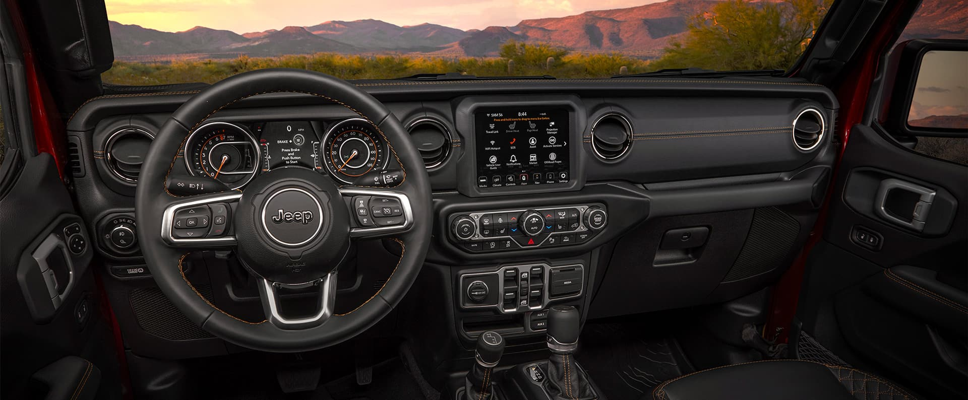 The interior of the 2021 Jeep Gladiator Overland, focusing on the steering wheel and instrument panel.