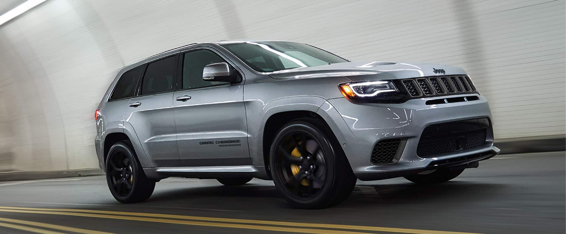 The 2021 Jeep Grand Cherokee Trackhawk being driven through a tunnel.