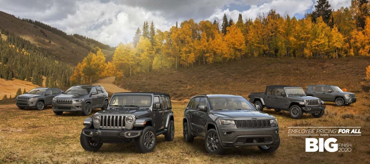The 2021 80th Anniversary Jeep Brand lineup parked on a grassy autumn terrain, front row: Wrangler 80th Anniversary, Grand Cherokee 80th Anniversary and back row: Compass 80th Anniversary, Cherokee 80th Anniversary, Gladiator 80th Anniversary, Renegade 80th Anniversary, with Employee Pricing for all During Black Friday Sales Event Logo.
