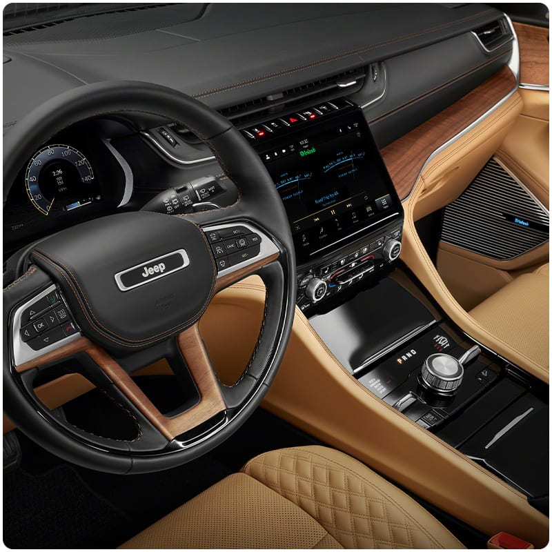 A close-up of the steering wheel in the 2021 Jeep Grand Cherokee L.