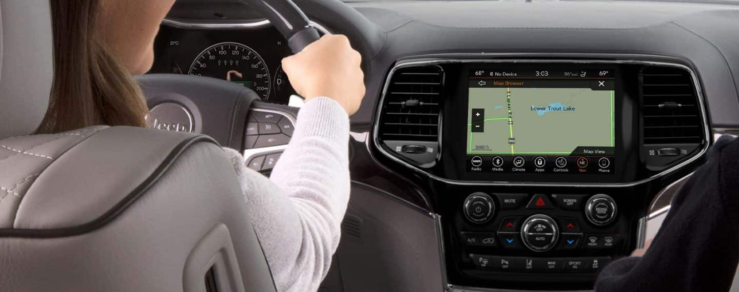 Close-up of touchscreen with navigation features on it.